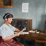 "This colorized image shows Mary Texanna Loomis, the first woman in the U.S. to run a radio school, operating her radio station in 1921. Her school, the Loomis Radio College, operated in Washington, D.C., in the 1920's and 1930's. She is seated at an early receiver that uses a panel mounted crystal detector. The knife switches to the right are probably antenna selectors. Next to that is an antenna tuner called a ""loose coupler"", which is connected to a tube receiver out of view on the right."