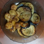 Roasted sweet potatoes with bananas fried on butter and honey